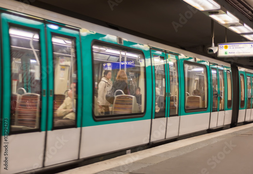 Metro train in a Paris station, France Photo by jovannig
