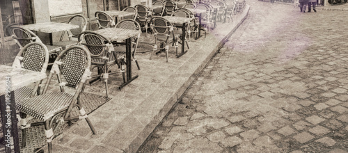 Outdoor restaurant tables in Paris, vintage view - 101295694