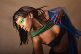 Studio portrait of pretty glamour girl with brazilian makeup