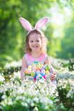 Fototapety Little girl with Easter bunny ears