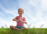 child practicing yoga