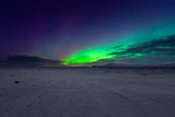 A beautiful green aurora or Northern Lights dancing