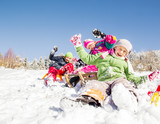 Fototapety Happy children  at winter time. Group of children spending a nice time in snow