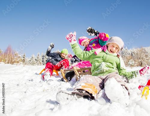 Leinwandbild Motiv Happy children  at winter time. Group of children spending a nice time in snow