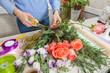 Obrazy na płótnie, fototapety, zdjęcia, fotoobrazy drukowane : Florist at work with flowers
