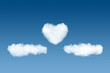 clouds and heart backdrop on blue sky background