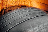 used car tire with worn-out depth of thread