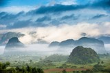 Peaceful view of Vinales valley at sunrise. Aerial View of the Vinales Valley in Cuba. Morning twilight and fog. Fog at dawn in the Valley of Vinales in Pinar del Rio