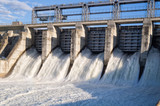 Water rushing out of opened gates of a hydro electric power dam  - 101391021