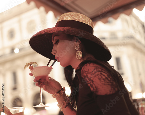 Beautiful vintage portrait of woman drinking cocktail Poster