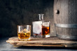 Постер, плакат: Glass of whiskey with ice decanter and barrel
