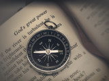 Bible on compass - religion faith concept image