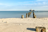 Beach in Gdynia at Baltic sea with view on ruins of torpedo from second world`s war.
