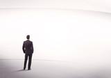 Businessman with briefcase standing still