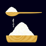 Granulated salt or sugar in a wooden bowl and in a wooden spoon.