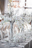 Fototapety Wedding reception with floral arrangement of white orchids