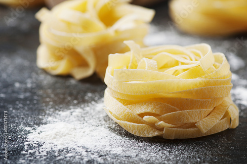 Plagát Uncooked pasta with flour on the table