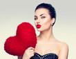 Obrazy na płótnie, fototapety, zdjęcia, fotoobrazy drukowane : Gorgeous young brunette woman with heart shaped red pillow