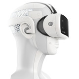 Unusual virtual reality headset with integrated headphones on a white robot. 3d concept isolated on white background. Side view