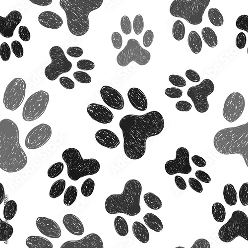 Fototapeta Paws print seamless pattern. Vector background with doodle dogs paws.