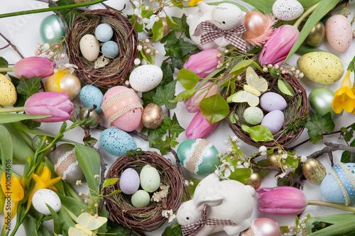Fototapeta Assorted eggs and flowers for Easter on white