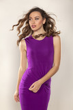 beautiful young woman posing in violet tight short dress
