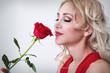 Obrazy na płótnie, fototapety, zdjęcia, fotoobrazy drukowane : Beautiful woman with a rose