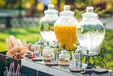 Fototapety Glass jars of lemonade and decor on wedding candy bar