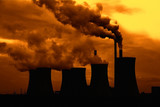 View of smoking coal power plant at sunset