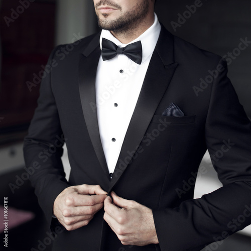 Sexy man in tuxedo and bow tie Poster