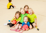 Fototapety Happy children in gym