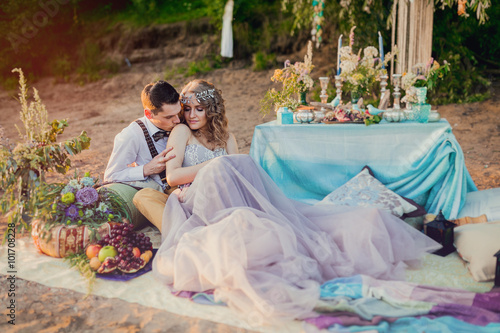 Poster Boho chic couple in love the bride and groom. Wedding inspiratio