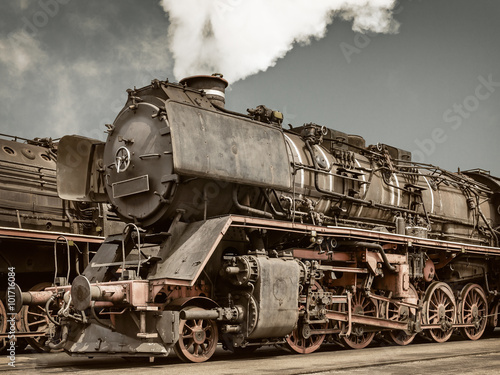 Retro styled image of an old steam locomotive Poster
