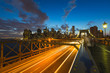 Traffic on Brooklyn bridge in New York at dusk