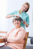 Caregiver doing senior woman