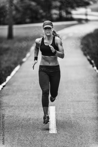 Fototapeta Woman jogging in black and white