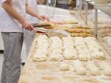Chefs forming dough in order to prepare bread