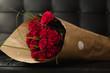 Obrazy na płótnie, fototapety, zdjęcia, fotoobrazy drukowane : Bouquet of red roses on black background