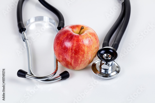 Good health with fresh red apple and stethoscope Plakat