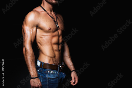 Muscular and sexy torso of young man in jeans Plakát