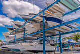 Boats stored up in dry storage waiting for maintenance - 101832832