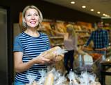 Customers buying bread in food shop