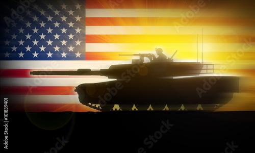 Sylwetka czołgu Abrams M1A2 porusza się szybko na tle amerykańskiej flagi.