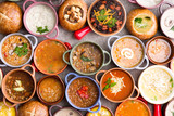 Variety of Garnished Soups in Colorful Bowls