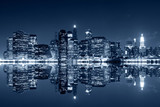 Fototapeta Nowy Jork - Manhattan at night with reflections on Harlem river © Evgeny Dubinchuk