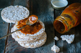 Rice cakes with salted caramel on old wooden background
