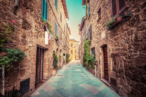 Narrow street in an old Italian town of Pienza. Tuscany, Italy. Vintage