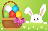 Lurking Easter bunny by basket with eggs