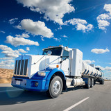 Truck and highway at day - transportation background - 101902605