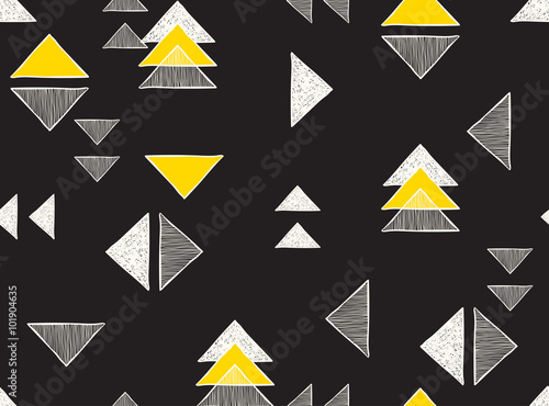 Seamless hand-drawn triangles pattern. © bosotochka